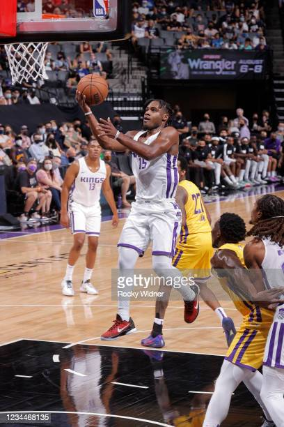 Davion Mitchell of the Sacramento Kings drives to the basket against the Los Angeles Lakers during the 2021 California Classic Summer League on...