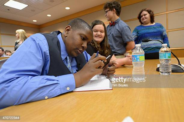 Davion Navar Henry Only writes in his new journal with his new family Carley Going Taylor Going and Sydney Going during their formal adoption...