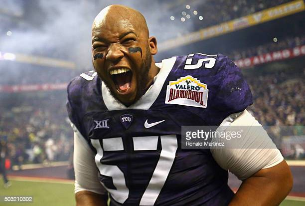 Davion Pierson of the TCU Horned Frogs celebrates after winning the Valero Alamo Bowl in three overtimes against the Oregon Ducks at Alamodome on...