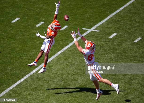 Davis Allen of the Clemson Tigers makes the reception as Nate Wiggins defends during the second half of the Clemson Orange and White Spring Game at...