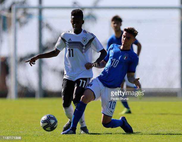 Davis Asante of Germany U16 competes for the ball with Federico Zuccon of Italy U16 during the International Friendly match between Italy U16 and...
