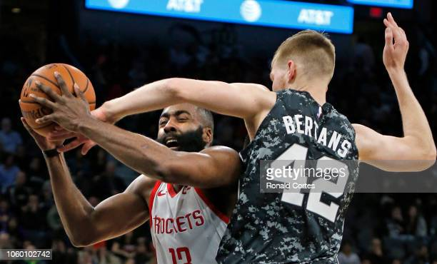 Davis Bertans of the San Antonio Spurs blocks shot attempt of James Harden of the Houston Rockets at ATT Center on November 10 2018 in San Antonio...