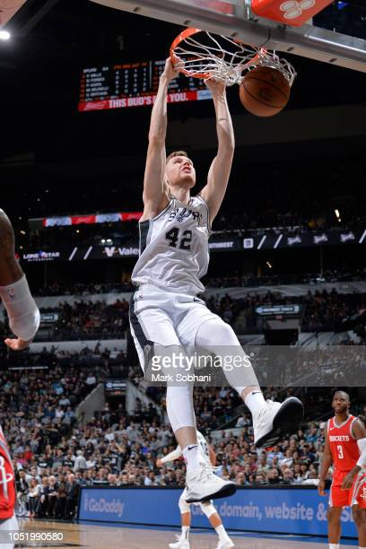 Davis Bertans of the San Antonio Spurs dunks the ball against the Houston Rockets during a preseason game on October 7 2018 at the ATT Center in San...
