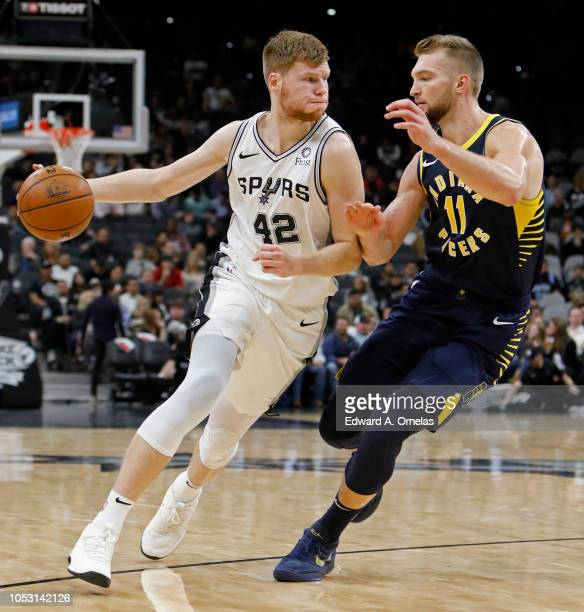 Davis Bertans of the San Antonio Spurs looks for room around Domantas Sabonis of the Indiana Pacers during an NBA game on October 24 2018 at the ATT...