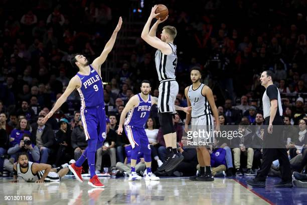 Davis Bertans of the San Antonio Spurs puts up a shot over Dario Saric of the Philadelphia 76ers at Wells Fargo Center on January 3 2018 in...