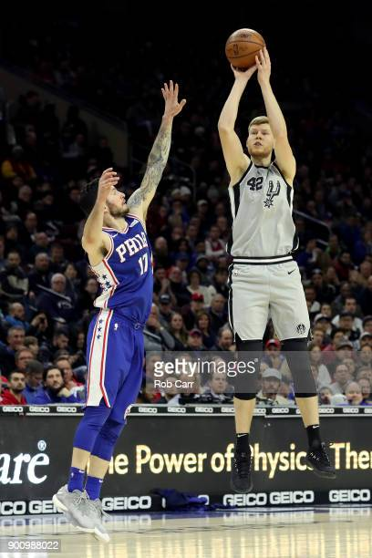 Davis Bertans of the San Antonio Spurs puts up a shot over JJ Redick of the Philadelphia 76ers in the first half at Wells Fargo Center on January 3...