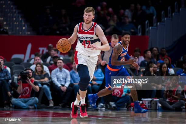 Davis Bertans of the Washington Wizards dribbles the ball during the second half against the New York Knicks at Capital One Arena on October 7 2019...
