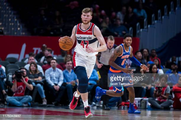 Davis Bertans of the Washington Wizards handles the ball against the New York Knicks during the second half at Capital One Arena on October 7 2019 in...