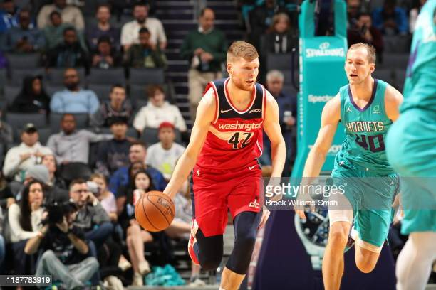 Davis Bertans of the Washington Wizards handles the ball against the Charlotte Hornets on December 10 2019 at Spectrum Center in Charlotte North...