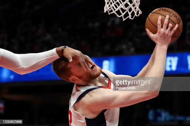 Davis Bertans of the Washington Wizards is fouled by Markieff Morris of the Detroit Pistons during the second half at Capital One Arena on January...