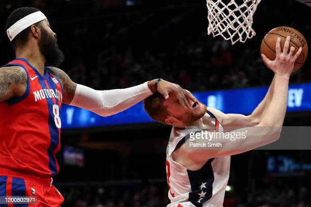 Davis Bertans of the Washington Wizards is fouled by Markieff Morris of the Detroit Pistons during the second half at Capital One Arena on January 20...