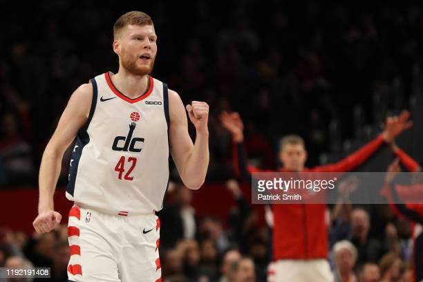 Davis Bertans of the Washington Wizards reacts against the Philadelphia 76ers during the first half at Capital One Arena on December 5 2019 in...