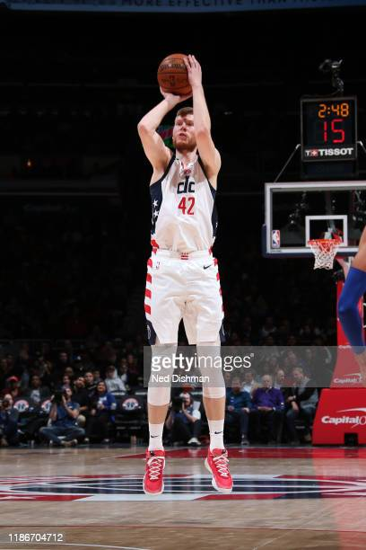 Davis Bertans of the Washington Wizards shoots a threepointer against the Philadelphia 76ers on December 5 2019 at Capital One Arena in Washington DC...