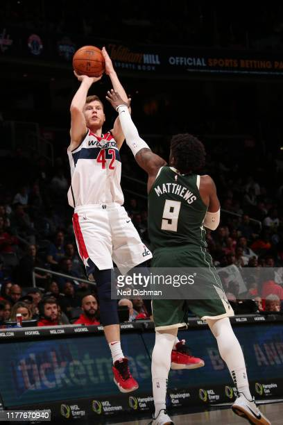 Davis Bertans of the Washington Wizards shoots the ball against the Milwaukee Bucks during a preseason game on October 13 2019 at Capital One Arena...