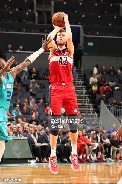 Davis Bertans of the Washington Wizards shoots the ball against the Charlotte Hornets on December 10 2019 at Spectrum Center in Charlotte North...