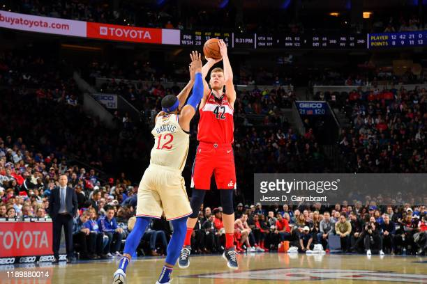Davis Bertans of the Washington Wizards shoots the ball against the Philadelphia 76ers on December 21 2019 at the Wells Fargo Center in Philadelphia...