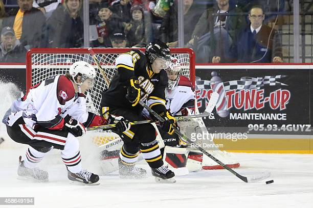 Davis Brown of the Sarnia Sting tries to bat home a rebound against Brent Moran of the Niagara IceDogs at the Meridian Center on November 8 2014 in...