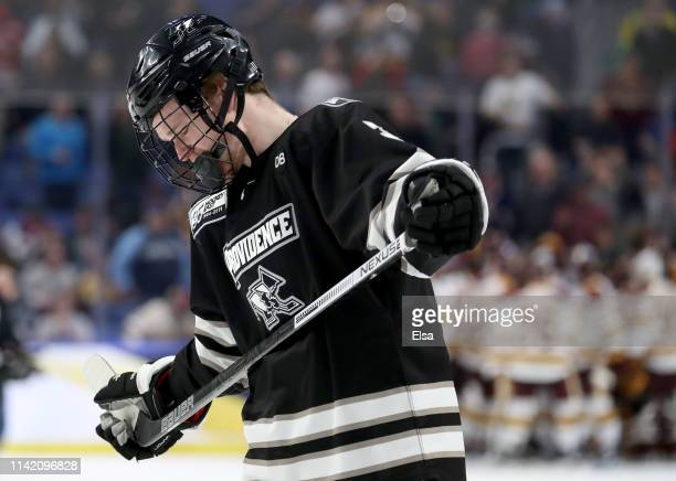 Davis Bunz of the Providence Friars reacts to the 41 loss to the MinnesotaDuluth Bulldogs during the semifinals of the NCAA Men's Frozen Four at...