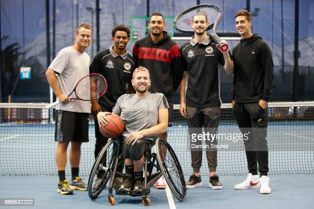 Davis Cup captain Leighton Hewitt poses for a photo with Melbourne United NBL basketballers Chris Goulding and Casper ware during an Australian Open...
