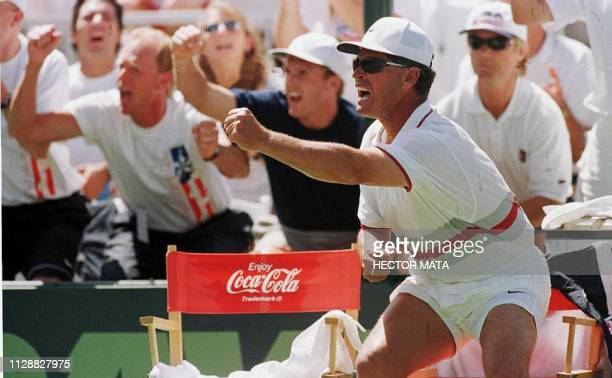 US Davis Cup coach Tom Gullickson reacts to match point during Andre Agassi's match against Jan Siemerink of the Netherlands 06 April during their...