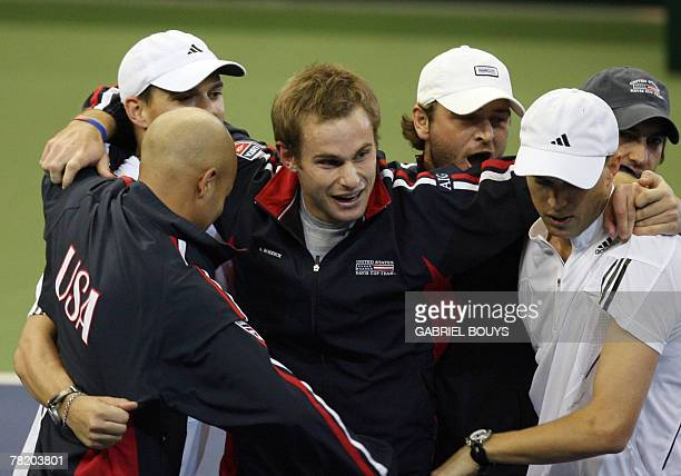 US Davis Cup double players Bob and Mike RL Bryan are congratuled by teammate Andy Roddick after they won the 2007 Davis Cup final against Russia 01...