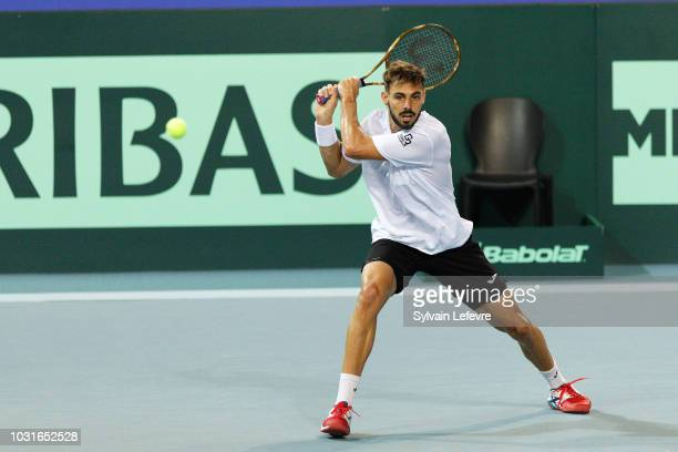 Davis Cup Spain team member Marcel Granollers returns the ball during first training sessions for Cup Davis semi-final on September 11, 2018 in...