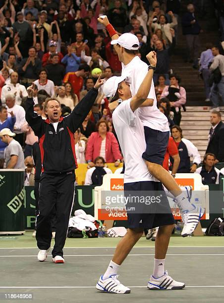 Davis Cup team members Bob and Mike Bryan celebrate defeating Spain's Feliciano Lopez and Fernando Verdasco in the 2007 Davis Cup quarterfinals at...
