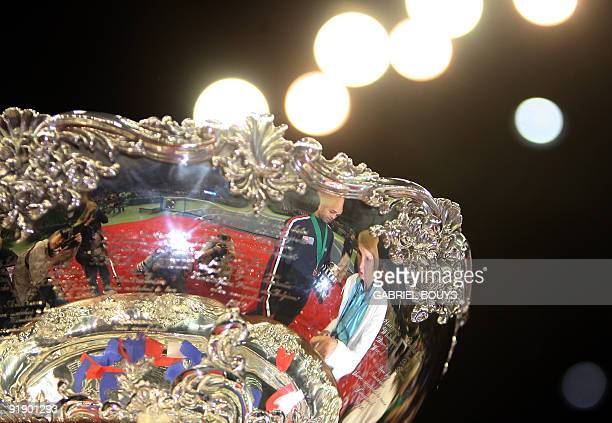 US Davis Cup team player James Blake and his mother Betty are reflected in the trophy of the 2007 Davis Cup after the US victory against Russia 02...