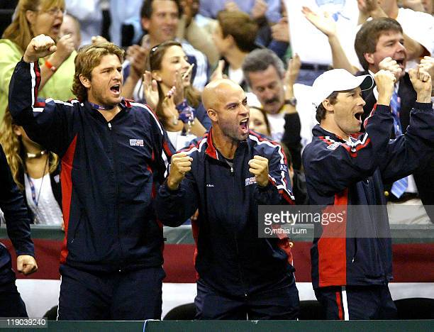 Davis Cup teammates Mardy Fish James Blake and Roddicks trainer Doug Spreen cheer Roddick on to deafeat Spain's Fernando Verdasco 76 61 64 during the...