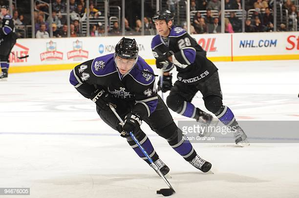 Davis Drewiske of the Los Angeles Kings skates with the puck during a game against the Calgary Flames at Staples Center on November 21, 2009 in Los...