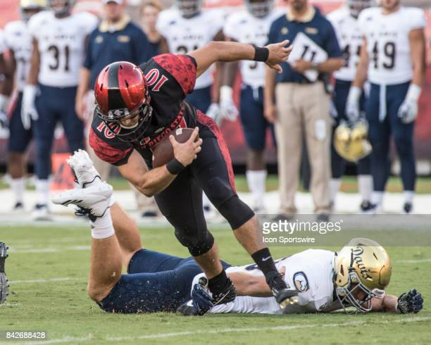 Davis Erik Holmer sacks SDSU Christian Chapman during the college football game between UC Davis Aggies and San Diego State University Aztecs on...