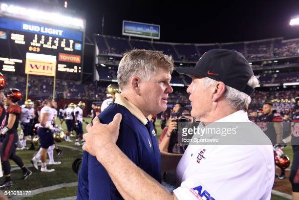 Davis Head Coach Dan Hawkins and SDSU Head Coach Rocky Long exchange thoughts after the college football game between UC Davis Aggies and San Diego...