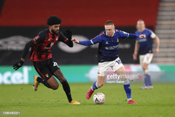 Davis Keillor-Dunn of Oldham Athletic battles for possession with Philip Billing of AFC Bournemouth during the FA Cup Third Round match between...