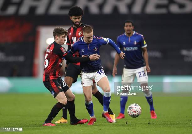 Davis Keillor-Dunn of Oldham Athletic is challenged by Gavin Kilkenny and Philip Billing of AFC Bournemouth during the FA Cup Third Round match...