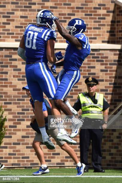 Davis Koppenhaver and TJ Rahming of the Duke Blue Devils celebrate following a touchdown by Koppenhavey during their game against the Northwestern...