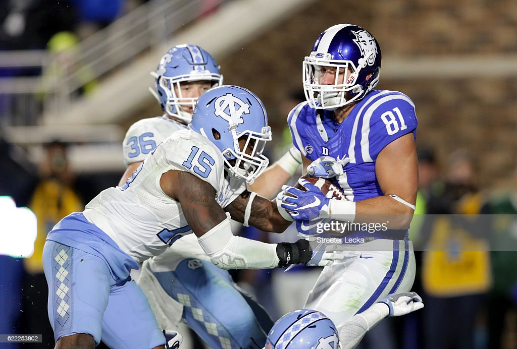 Davis Koppenhaver #81 of the Duke Blue Devils catches a touchdown over Donnie Miles #15 of the North Carolina Tar Heels during their game at Wallace Wade Stadium on November 10, 2016 in Durham, North Carolina.