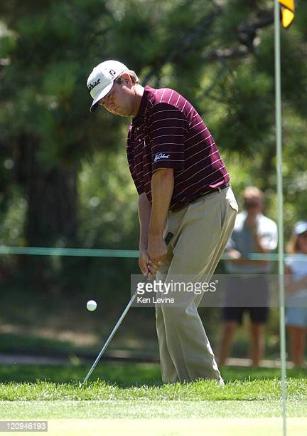 Davis Love III hits a pitch shot on the 7th hole during the final round of the International Golf Tournament at Castle Pines at Castle Pines Colorado...