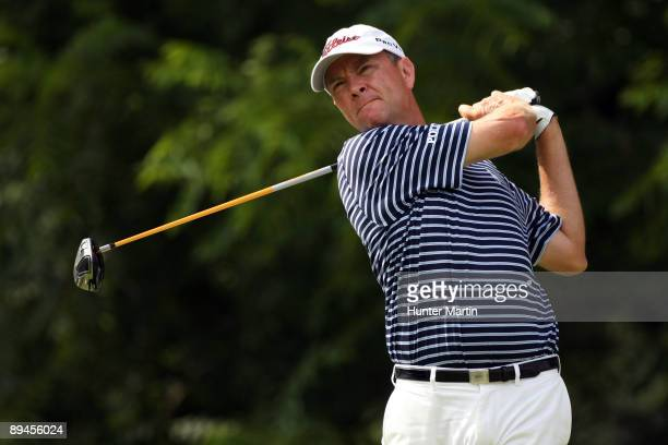 Davis Love III hits a shot during the second round of the AT&T National hosted by Tiger Woods at Congressional Country Club on July 3, 2009 in...