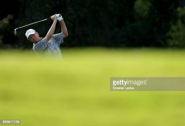 Davis Love III hits a tee shot on the 16th hole during the third round of the Wyndham Championship at Sedgefield Country Club on August 19 2017 in...