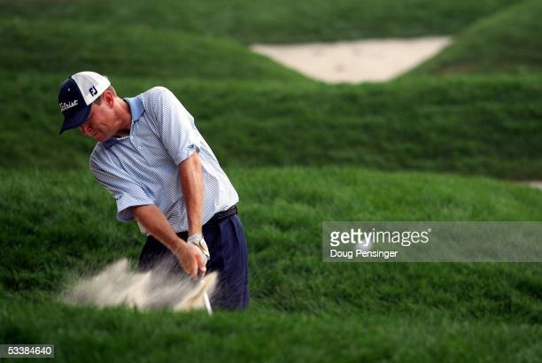 Davis Love III hits out of a bunker on the 18th hole during the third round of the 2005 PGA Championship at Baltusrol Golf Club on August 13, 2005 in...