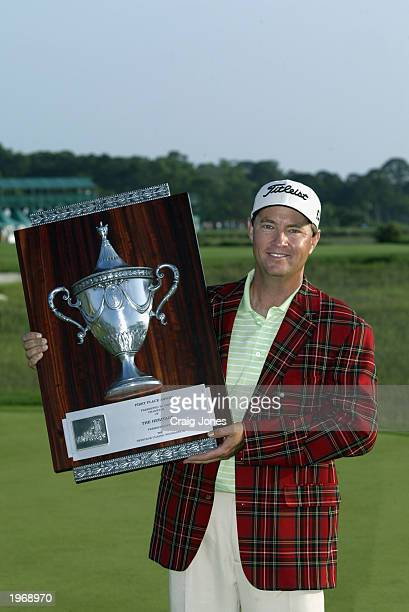 Davis Love III holds the champions trophy after the final round of the MCI Heritage Classic on April 20 2003 at the Harbour Town Golf Links in Hilton...