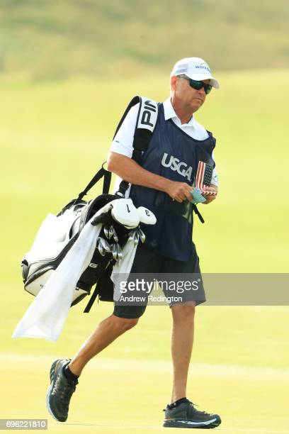 Davis Love III of the United States caddies for son Davis Love IV during the first round of the 2017 U.S. Open at Erin Hills on June 15, 2017 in...
