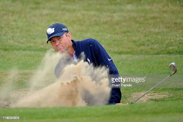 Davis Love III of the United States hits from a bunker on the 6th hole during the first round of The 140th Open Championship at Royal St George's on...
