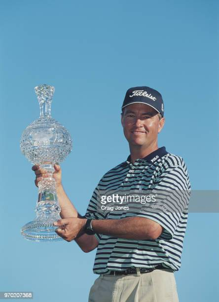 Davis Love III of the United States holds the trophy after winning the ATT Pebble Beach ProAm golf tournament on 4 February 2001 at the Pebble Beach...