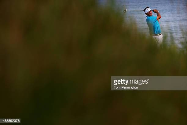 Davis Love III of the United States watches his tee shot on the 18th hole during the first round of the 2015 PGA Championship at Whistling Straits on...