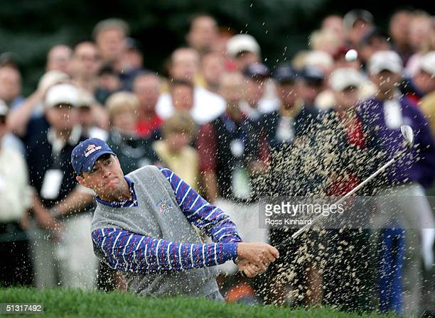 Davis Love III of the USA plays out the bunker on the second hole during his four-ball match against European team players Darren Clarke of Ireland...