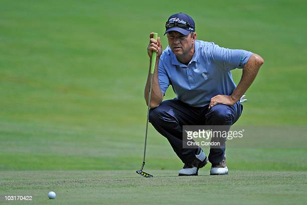 Davis Love III of USA lines up a birdie putt on during the second round of The Greenbrier Classic at The Greenbrier Resort on July 30, 2010 in White...