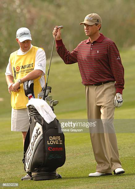 Davis Love III pulls a club from his bag on the second fairway during the first round of the Target World Challenge Presented by Countrywide at the...
