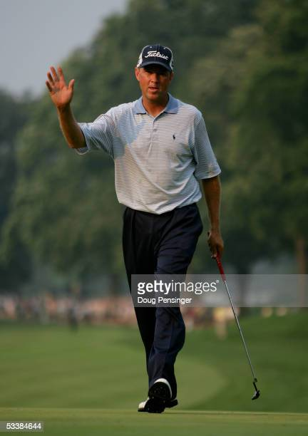Davis Love III waves after making birdie on the 15th hole during the third round of the 2005 PGA Championship at Baltusrol Golf Club on August 13,...