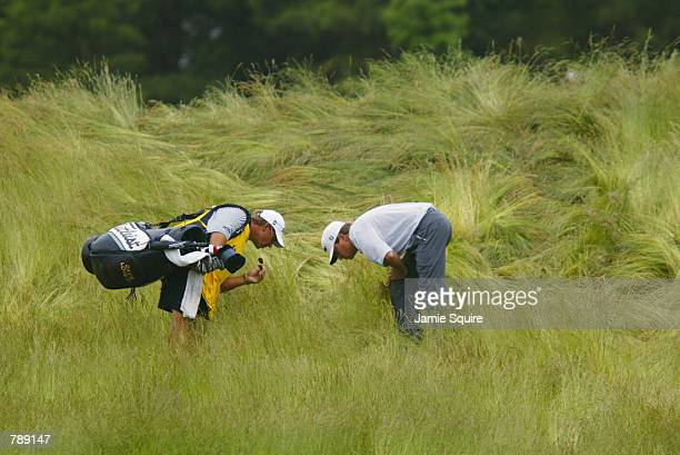 Davis Love the III searches for his ball in the deep grass on the 10th fairway during the third round of the 102nd US Open on the Black Course at...